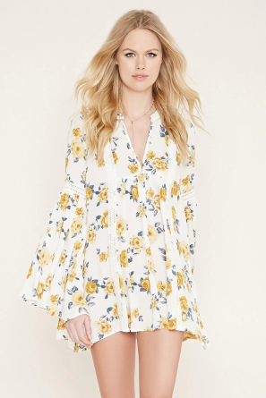 This white/cream floral dress is perfect for spring-- the colors are just bright enough, and the flowers are super-cute. The wide sleeves are cute and comfy. I'd wear this to school, but make sure it's long enough so you don't get in trouble!